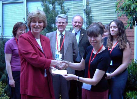 Ann presents the boys' cheque to Marilyn Rydström, Director General of PDSA